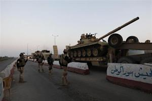 A military convoy drives towards Anbar, to reinforce Iraqi troops in the province, west of Baghdad