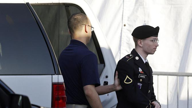 Army Pfc. Bradley Manning, right, is escorted from a security vehicle to a courthouse in Fort Meade, Md., Wednesday, April 10, 2013, before a pretrial military hearing. Manning, who is charged with causing hundreds of thousands of classified documents to be published on the secret-sharing website WikiLeaks, is scheduled to face a court martial in June. (AP Photo/Patrick Semansky)