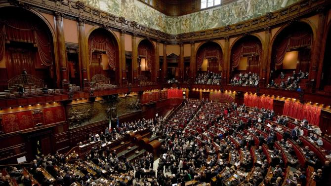 Italian lawmakers gather to vote on a new president whose first job will be to seek the formation of a new government after inconclusive elections, in Rome Thursday, April 18, 2013. Political parties sparred over suitable candidates for the post being vacated by Giorgio Napolitano ahead of the Thursday vote, reflecting divisions that they have been unable to overcome in the more than 50 days since the Feb. 24-25 elections. Napolitano's term expires next month. (AP Photo/Alessandra Tarantino)
