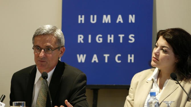 Eric Goldstein, deputy director of Human Rights Watch's Middle East and North Africa division, left, and Tamara Al Rifai, Director, Advocacy and Communications Middle East and North Africa right, speak to media during a news conference inRabatFriday,June 21, 2013. Human Rights Watch says in a new report that Morocco's justice system overly relies on coerced confessions and needs serious reform. (AP Photo/Abdeljalil Bounhar)