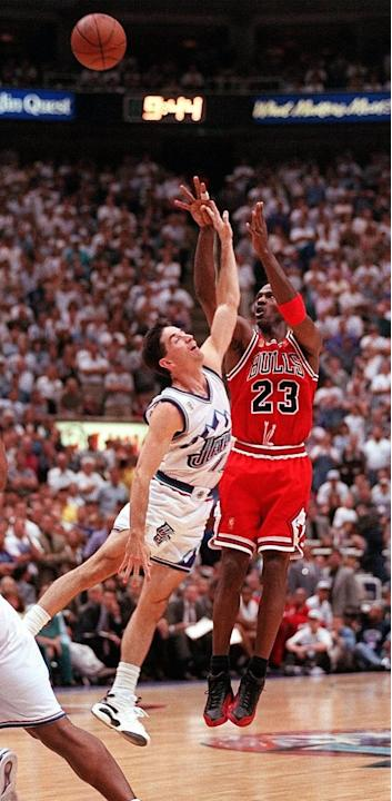 Chicago Bulls Michael Jordan makes his final 3-point shot over the top of Utah Jazz's John Stockton during the fourth quarter of Game 5 of the NBA Finals Wednesday, June 11, 1997, in Salt Lake Cit