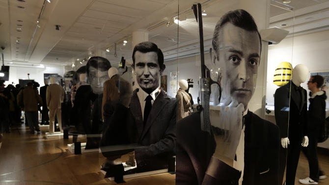 A general view of the James Bond movie memorabilia charity auction at Christie's auction house during the press pre-view showing large portraits of the actors who have portrayed the famous movie icon James Bond, with Sean Connery, at right,  in London, Friday, Sept. 28, 2012. (AP Photo/Alastair Grant)