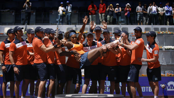 Serena Williams from U.S. is tossed by ball boys while she poses for pictures after winning the final of the Madrid Open tennis tournament against Maria Sharapova from Russia, in Madrid Sunday, May 12, 2013. (AP Photo/Daniel Ochoa de Olza)