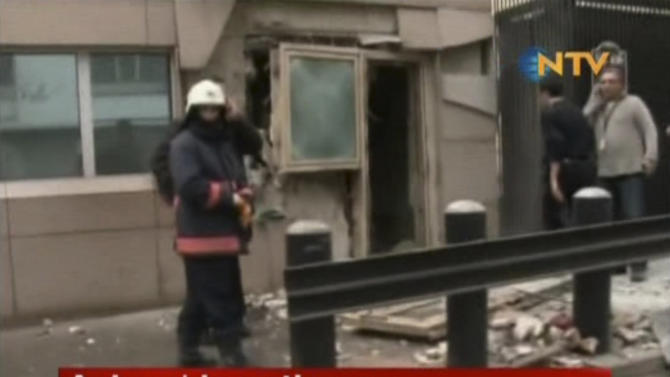 In this image made from video, emergency personnel are seen in front of a side entrance to the U.S. Embassy following a blast, Ankara, Turkey, Friday, Feb. 1, 2013. Turkish news reports say an explosion in front of the U.S. Embassy in the Turkish capital Ankara has injured several people. (AP Photo/NTV) TURKEY OUT