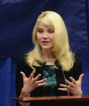 FILE - In this Oct. 30, 2012 file photo, Elizabeth Smart speaks to reporters regarding her advocacy of child protection and the healing process she has experienced, prior to her presentation at the Child Sexual Abuse Conference, in State College, Pa. Ten years after her kidnapping, Smart is preparing her story of being held captive by a homeless street preacher, her improbable rescue after nine months, and how she advocated for children after the ordeal. (AP Photo/Ralph Wilson, File)