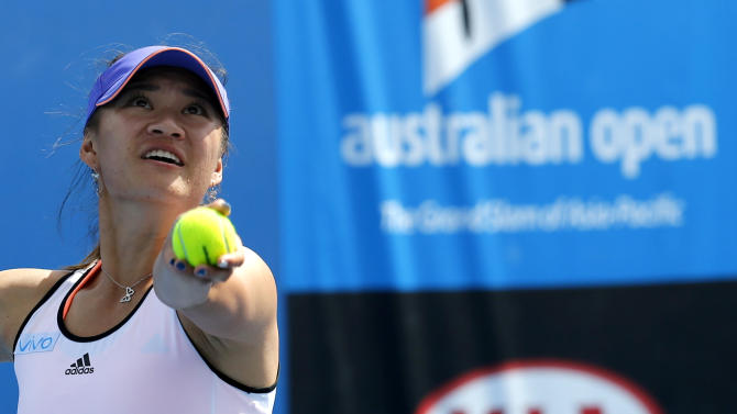 China's Xu Shilin, with playing partner Australia's Sara Tomic, serves as they play Czech Republic's Miriam Kolodziejova and Marketa Vondrousova during junior girls' doubles semifinal at the Australian Open tennis championship in Melbourne, Australia, Thursday, Jan. 29, 2015. Xu, who just turned 17 and goes by the English name Coco, was the first Chinese girl to be No. 1 in the world junior rankings and won the gold medal at the Youth Olympic Games last year. (AP Photo/Shuji Kajiyama)