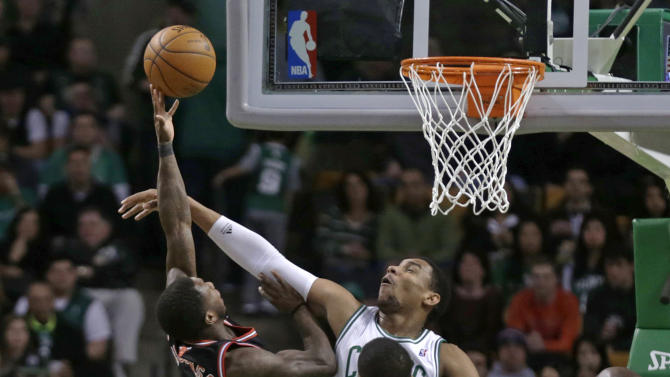 Boston Celtics forward Jared Sullinger blocks Chicago Bulls point guard Nate Robinson (2) on a drive to the basket during the first half of an NBA basketball game in Boston on Friday, Jan. 18, 2013. (AP Photo/Charles Krupa)