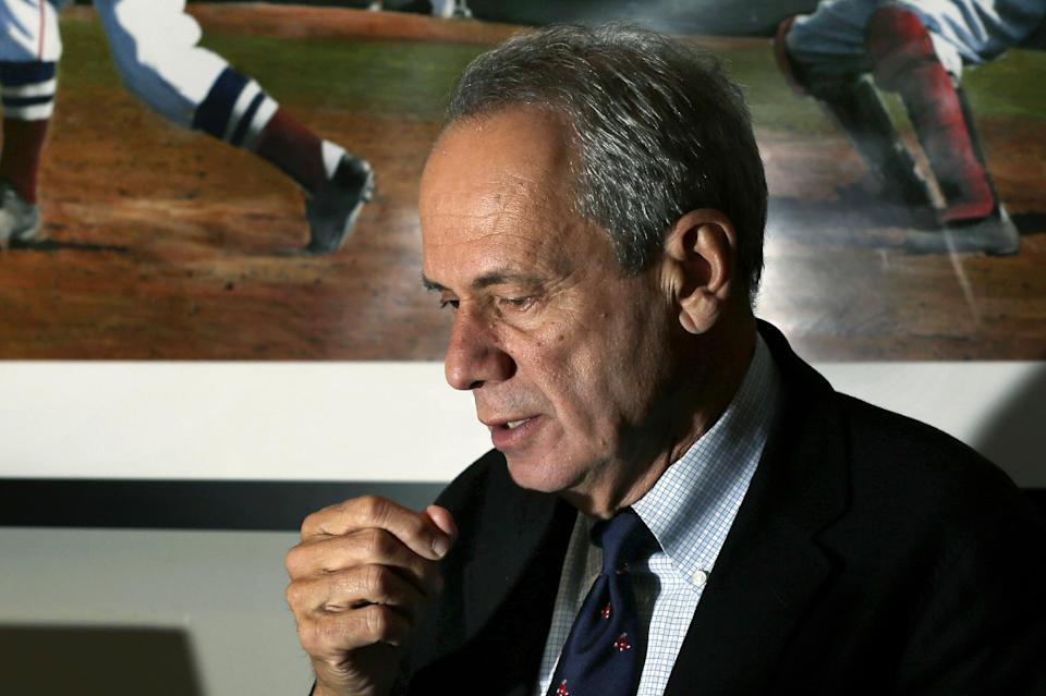 Boston Red Sox President and CEO Larry Lucchino speaks during an interview at Fenway Park in Boston, Thursday, Oct. 4, 2012, hours after the team announced that manager Bobby Valentine will not return in 2013. The Red Sox finished their baseball season in last place for the first time in 20 years. (AP Photo/Elise Amendola)
