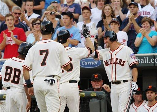 Plouffe homers twice, Twins beat Royals 10-8