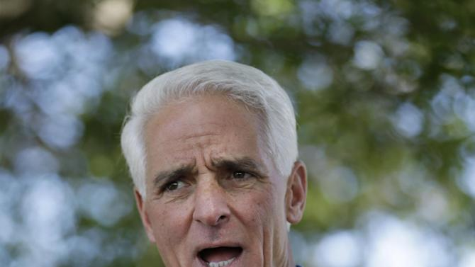 FILE- In this Oct. 25, 2014 file photo, Florida Democratic gubernatorial candidate Charlie Crist gestures as he speaks to supporters during a campaign stop in Riviera Beach, Fla. Crist could be a candidate for a congressional seat if new congressional maps are drawn. A special session to deal with redrawing eight of Florida's 27 district will start in August. (AP Photo/Wilfredo Lee, File)