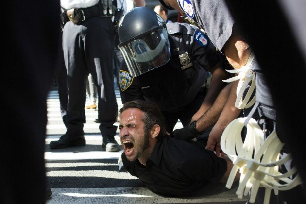 An Occupy protester screams as he is arrested near Zuccotti Park, Sept. 17, 2012. (John Minchillo/AP)