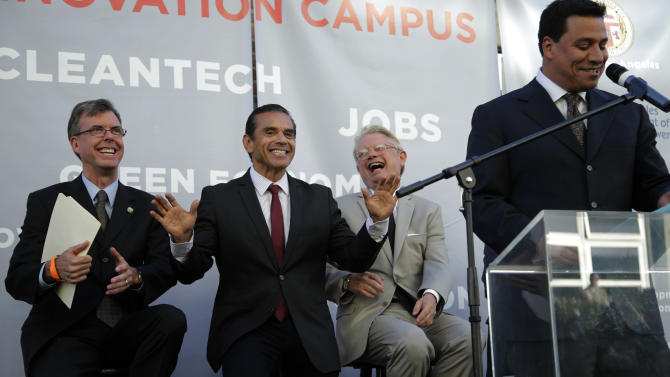 Los Angeles Mayor Antonio Villaraigosa, flanked by Los Angeles City Engineer Gary Lee Moore, left, and Cleantech Incubator Executive Director Fred Walti, jokes as Los Angeles City Council member Jose Huizar, right, delivers his remarks during a groundbreaking ceremony for the La Kretz Innovation Campus in Los Angeles, Wednesday, June 19, 2013. Mayor Antonio Villaraigosa leaves office July 1 after an eight-year run at City Hall that began full of promise and ends with mixed results. (AP Photo/Jae C. Hong)