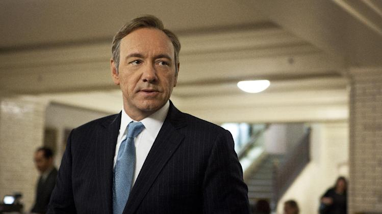 "FILE - This image released by Netflix shows Kevin Spacey as U.S. Congressman Frank Underwood in a scene from the Netflix original series, ""House of Cards. ""  This years Emmy Awards can be a toss-up between many shows, ""House of Cards"" is a contender for Best Drama Series.    (AP Photo/Netflix, Melinda Sue Gordon)"