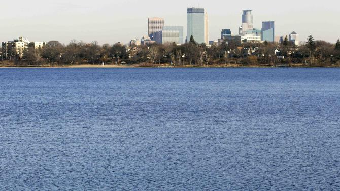 """The city of Minneapolis skyline rises Tuesday, Nov. 13, 2012 in the distance behind Lake Calhoun. A newly redistricted precinct map shows 3B is located entirely in the eastern half of Lake Calhoun in Minnesota. City Clerk Casey Carl says the watery precinct is the """"unintentional result of a programming error"""" made in drawing new ward boundary lines.  (AP Photo/Jim Mone)"""