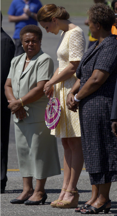 Britain's Kate, the Duchess of Cambridge, center, chats with Lady Kabui, left, the wife of the Solomon Islands' Governor General, and Madam Lilo, wife of the Solomon Islands prime minister, as Kate an