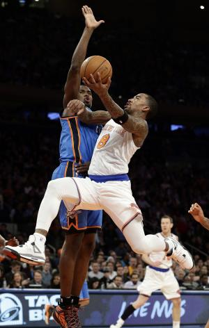 New York Knicks' J.R. Smith (8) drives past Oklahoma City Thunder's Serge Ibaka during the first half of an NBA basketball game Thursday, March 7, 2013, in New York.  (AP Photo/Frank Franklin II)