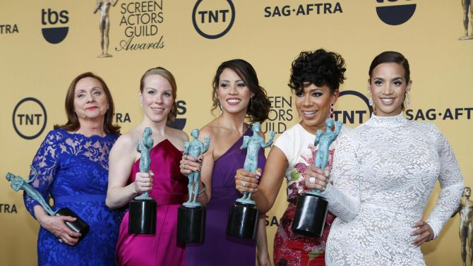 """The cast of the Netflix series """"Orange is the New Black"""" pose backstage with their awards for Outstanding Performance by an Ensemble in a Comedy Series at the 21st annual Screen Actors Guild Awards in Los Angeles"""