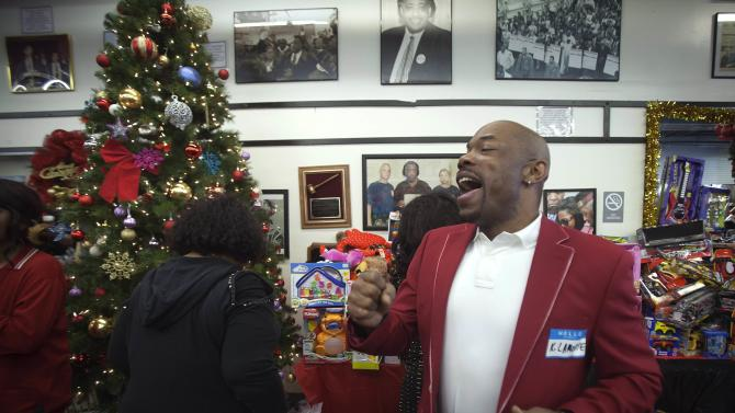 A man sings Christmas carols before dinner at the National Action Network in the Harlem section of New York