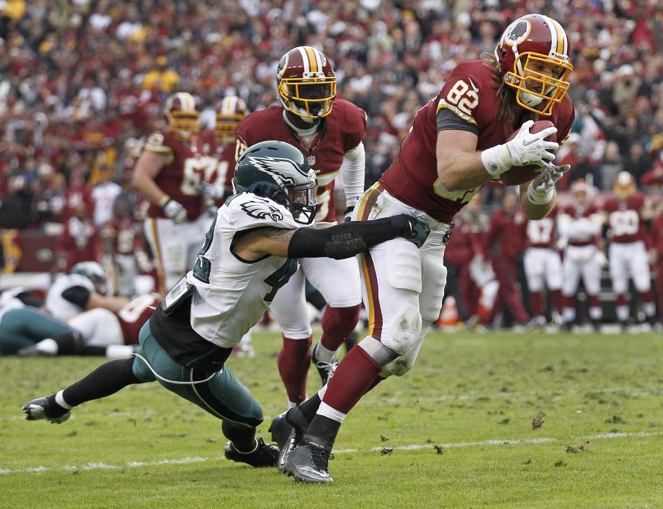 Philadelphia Eagles free safety Kurt Coleman, left, hangs onto Washington Redskins tight end Logan Paulsen as he heads for the end zone and a touchdown during the second half of an NFL football game in Landover, Md., Sunday, Nov. 18, 2012. (AP Photo/Alex Brandon)