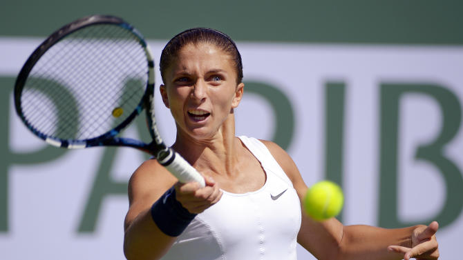 Sara Errani, of Italy, returns a shot against  Marion Bartoli, of France, during their match at the BNP Paribas Open tennis tournament, Tuesday, March 12, 2013, in Indian Wells, Calif. (AP Photo/Mark J. Terrill)