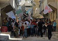 Syrians march in the street during a protest against the regime of Syrian President Bashar al-Assad in the northern city of Aleppo. The army took a pounding at the hands of rebels in northern Syria, a watchdog said, as tensions between Damascus and Ankara escalated over cargo seized from a Syrian passenger plane