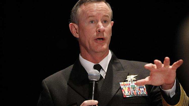 "FILE - Navy Adm. Bill McRaven, commander of the U.S. Special Operations Command, addresses the National Defense Industrial Association (NDIA), in Washington, in this Feb. 7, 2012 file photo. Special operations chief McRaven is warning he will take legal action against anyone under his command if they're found guilty of exposing sensitive information that could cause fellow forces harm. In an email Thursday Aug. 23, 2012  to special operations forces and obtained by The Associated Press, McRaven threatens to pursue ""every option available to hold members accountable, including criminal prosecution.""   (AP Photo/Charles Dharapak, File)"