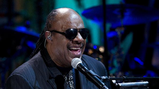 """FILE - In this May 9, 2012 file photo, Stevie Wonder performs during the """"In Performance at the White House"""" in the East Room of the White House in Washington, honoring songwriters Burt Bacharach and Hal David.  Authorities have charged two people, including a man who identifies as Wonder's nephew, with extortion for a plot in which they tried to trade what they said was embarrassing information in exchange for money. (AP Photo/Carolyn Kaster, File)"""