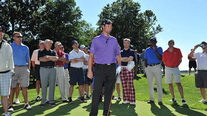 Professional golfer Webb Simpson leads walking clinic with Chase Sapphire cardholders on Monday Sept 10, 2012 at Robert Trent Jones Golf Club in Gainesville, Va. (Photo by Larry French/Invision for Chase Sapphire/AP Images)