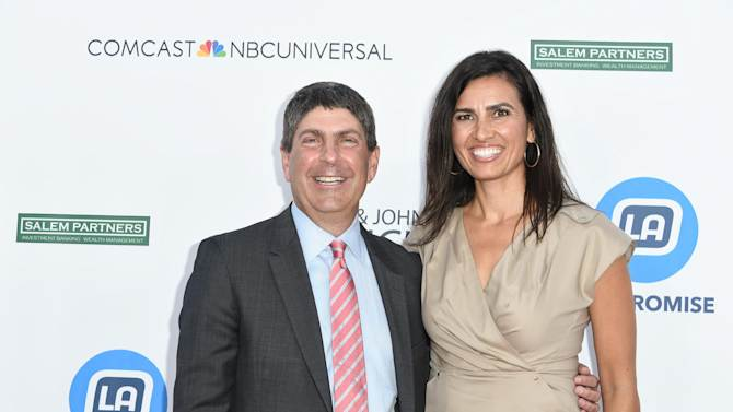 Jeff Shell, left, and Veronica Melvin arrive at the 2014 LA's Promise Gala on Tuesday, Sept. 30, 2014, in Universal City, Calif. (Photo by Rob Latour/Invision/AP)