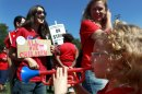 A young girl plays a toy horn as striking Chicago teachers rally Saturday, Sept. 15, 2012, in Chicago. Union president Karen Lewis reminded that although there is a