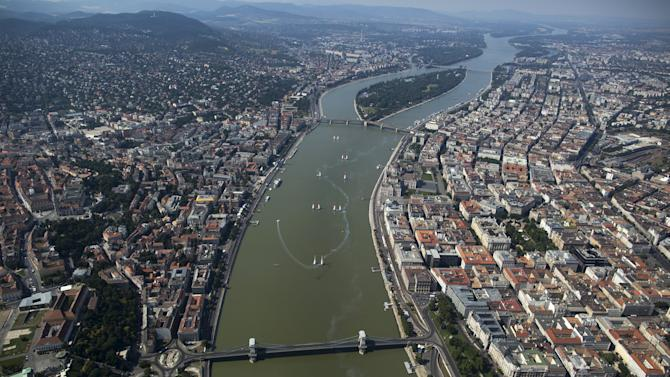 A general view shows the Red Bull Air Race World Championship as British pilot Paul Bonhomme files with his Edge 540 V2 in Budapest