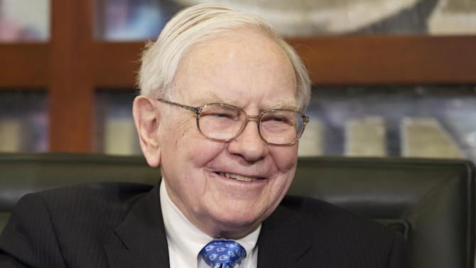 FILE - In this May 6, 2013 file photo, Warren Buffett smiles during a television interview in Omaha, Neb. Buffett released a positive annual letter Saturday, March 1, 2014. He told investors in the Omaha, Neb., based conglomerate that most of Berkshire's 80-odd subsidiaries had a good year last year. Buffett says Berkshire Hathaway shareholders should be confident in the company's prospects, even though the firm's results lagged behind the S&P 500 last year.  (AP Photo/Nati Harnik, File)