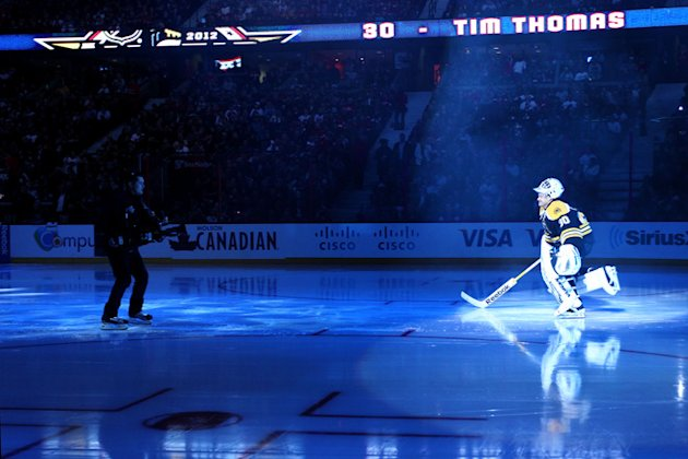 Tim Thomas #30 Of The Boston Bruins And Team Chara Gets Getty Images