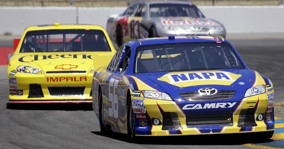 NASCAR driver Martin Truex Jr., (56) leads Clint Bowyer and Brian Vickers (83) through a turn during practice for Sunday's NASCAR Toyota Save Mart 350 auto race, Friday, June 24, 2011, at Infineon Raceway in Sonoma, Calif. (AP Photo/Ben Margot)