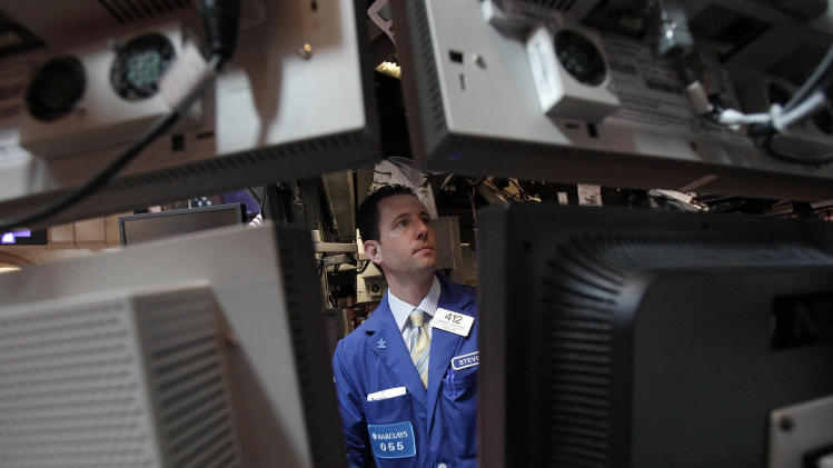 FILE- In this May 17, 2012 file photo specialist Stephen D'Agostino works at his post on the floor of the New York Stock Exchange. (AP Photo/Richard Drew, File)