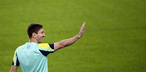 Barcelona's Lionel Messi salutes during a training session at Camp Nou stadium in Barcelona
