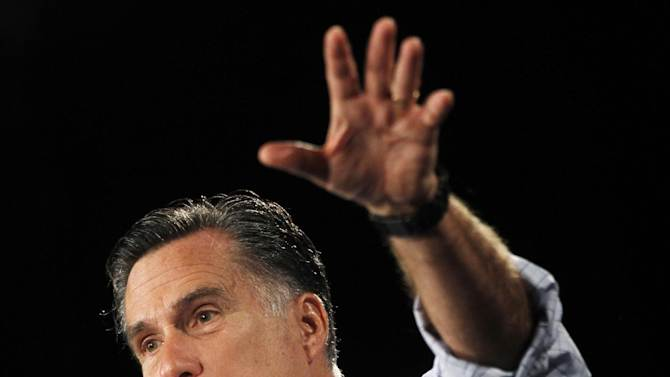 "In this photo taken Aug. 8, 2012, Republican presidential candidate, former Massachusetts Gov. Mitt Romney campaigns in Des Moines, Iowa. Welfare is causing a ruckus in the presidential campaign, but the program is a shadow of its old self in the 1970s, when Ronald Reagan used the image of ""welfare queens"" against government poverty programs promoted by liberals.  (AP Photo/Charles Dharapak)"