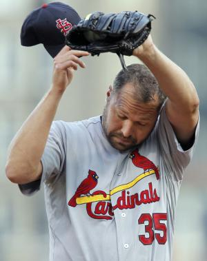 St. Louis Cardinals starting pitcher Jake Westbrook wipes his head after giving up a home run to Pittsburgh Pirates' Xavier Paul during the first inning of the baseball game on Monday, Aug. 15, 2011, in Pittsburgh. (AP Photo/Keith Srakocic)