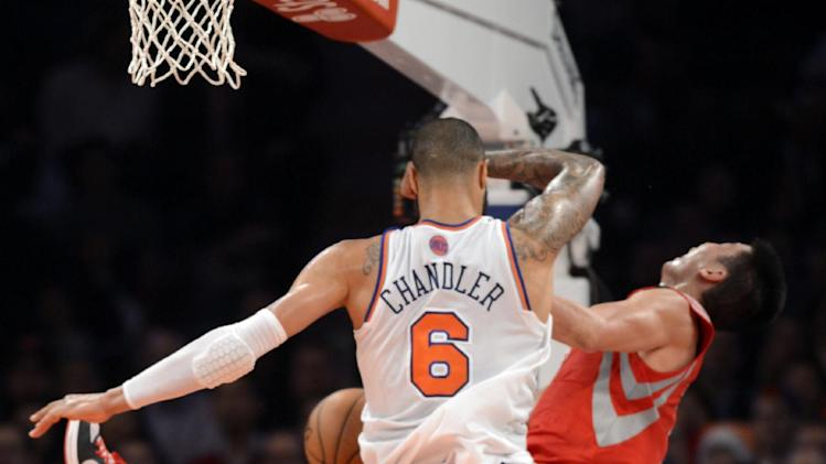 New York Knicks' Tyson Chandler, was given a flagrant foul for this collision with Houston Rockets' Jeremy Lin in the second quarter of the NBA basketball game at Madison Square Garden in New York, Monday, Dec. 17, 2012. (AP Photo/Henny Ray Abrams)