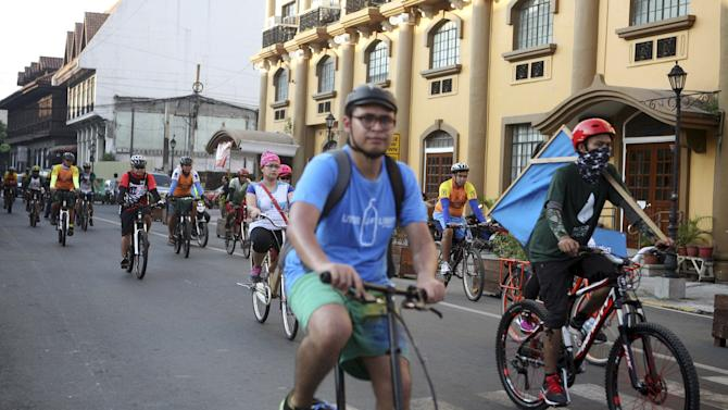 Filipino and foreign bicycle enthusiasts and diplomats take part in a bicycle ride movement for climate change in Manila
