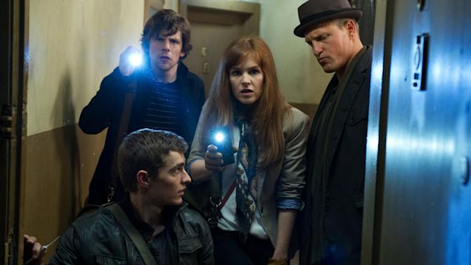 """This undated publicity photo released by Summit Entertainment, LLC shows, clockwise from bottom, Dave Franco, Jesse Eisenberg, Isla Fisher and Woody Harrelson, in a scene from the film, """"Now You See Me."""" (AP Photo/Summit Entertainment, LLC, Barry Wetcher, SMPSP)"""