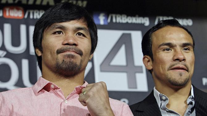 Manny Pacquiao, left, of the Philippines, and Juan Manuel Marquez, of Mexico, promote their upcoming boxing match during a news conference in Beverly Hills, Calif., Monday, Sept. 17, 2012. The two will fight for the fourth time on Dec. 8 in Las Vegas. (AP Photo/Reed Saxon)