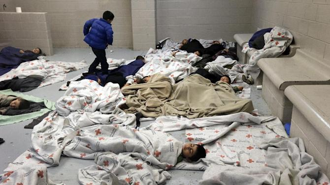 detainees sleep in a holding cell at a U.S. Customs and Border Protection processing facility in Brownsville,Texas