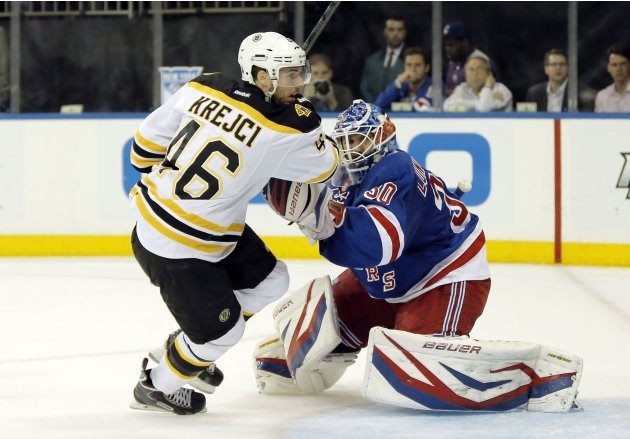 Boston Bruins' David Krejci battles New York Rangers' goalie Henrik Lundqvist in front of tjhe net as he chases a loose puck during action in the first period of Game 3 of their NHL Eastern Conference