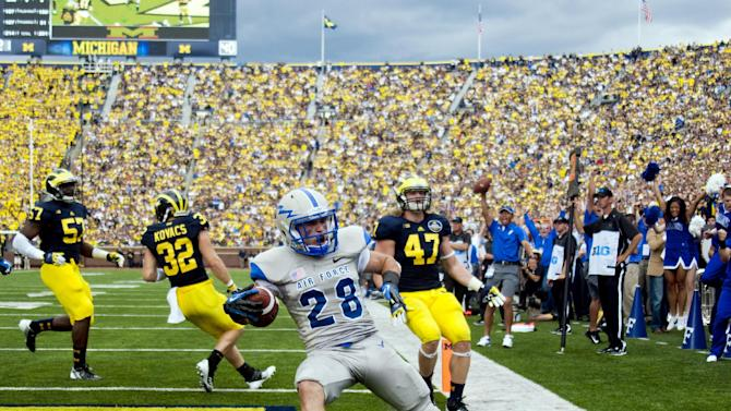 Air Force running back Cody Getz (28) celebrates his touchdown in the second quarter of an NCAA college football game with Michigan, Saturday, Sept. 8, 2012, in Ann Arbor, Mich. (AP Photo/Tony Ding)