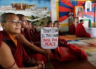 Tibetan nuns and monks participate in 24-hour hunger strike for victims of a Chinese crackdown in Ngaba in 2011. A Tibetan man set himself alight along the main street of Ngaba Monday, the latest in a series of shocking protests against Chinese rule, an overseas human rights group said