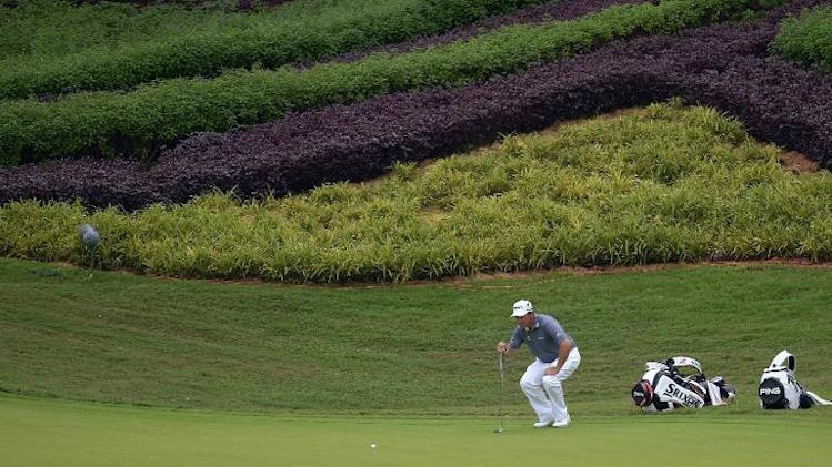 Lee Westwood lines up a putt on the fifteenth hole during the second round of the Maybank Malaysian Open in Kuala Lumpur on April 18, 2014