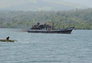 Photo illustration shows a Filipino-owned fishing boat sailing off from Masinloc town, north of Manila, for a fishing expedition near the Scarborough Shoal in May. The Philippines alleged on Sunday that a Chinese vessel accidentally rammed a local fishing boat north of a disputed South China Sea shoal, killing one and leaving four others missing