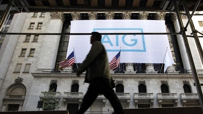 A banner for American International Group Inc hangs on the facade of the New York Stock Exchange