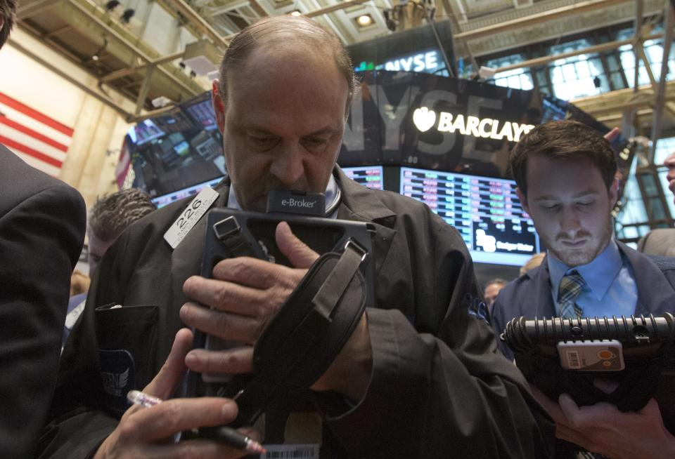 Trader Randy Biller, left, works on the floor of the New York Stock Exchange Thursday, May 23, 2013. A global stock market slump is continuing on Wall Street as traders worry about how committed the Federal Reserve remains to keeping up its bond-buying program. (AP Photo/Richard Drew)